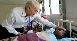 Father Michael Bassano, M.M. with a patient (South Sudan)