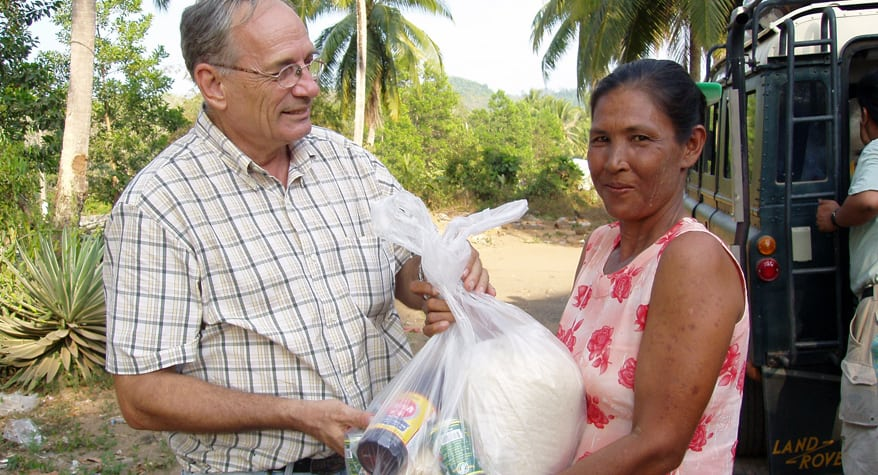Br. John Beeching, M.M. distributing food supplies