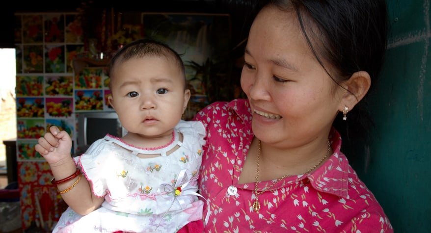 Mother holding her baby (Cambodia)
