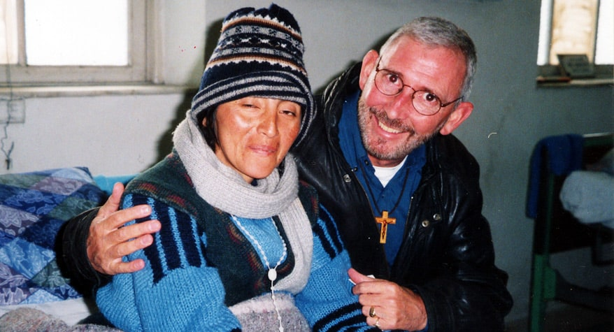 Father Joseph Fedora, M.M. with a patient (Peru)