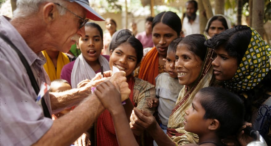 Father Bob McCahill, M.M. with people (Bangladesh)