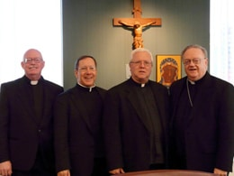 Monsignor Douglas Mathers, second from left, vice chancellor of the archdiocese and episcopal delegate for the cause, joins Auxiliary Bishop Dennis Sullivan, the archdiocese's vicar general, right; Father Edward M. Dougherty, M.M, superior general of the Maryknoll Fathers and Brothers, second from right; and Father Michael P. Walsh, M.M., member of the historical commission, left, at the swearing-in ceremony for the opening of the sainthood cause of Maryknoll co-founder Bishop James A. Walsh at the Catholic Center in Manhattan on November 9.