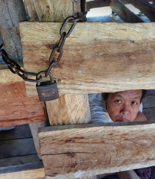 A woman caged and bound (Cambodia)