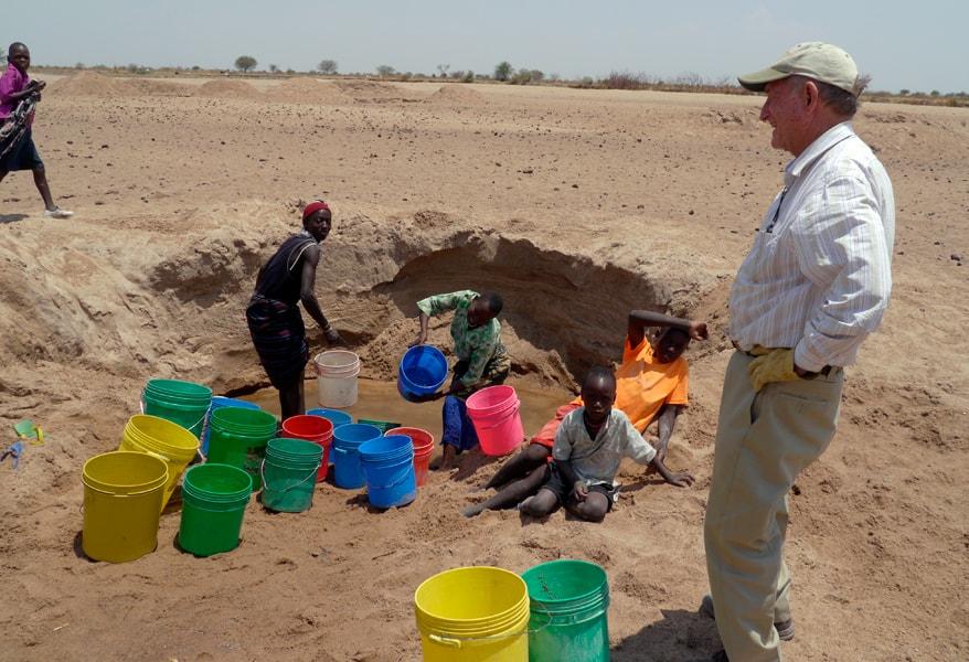Fr. Daniel Ohmann, M.M. helping people in Tanzania