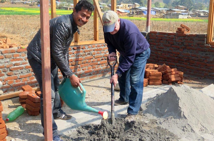 Mixing cement (Nepal)
