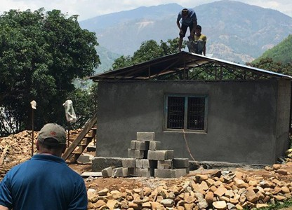 Fr. Thaler observes house being built (Nepal)