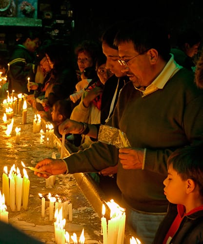 Devotees lighting candles (Bolivia)