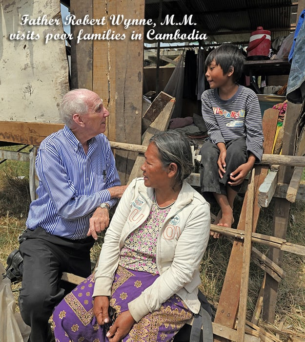 Father Robert Wynne, M.M. visits poor families (Cambodia)